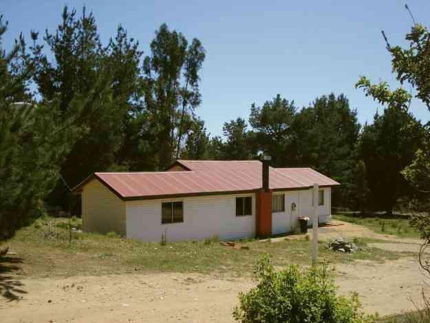 Terreno de 1.000 mts2 y casa habitacion. laguna verde. valor conversable $ 0.00