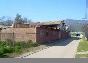 Vendo propiedad en curacavi con dos galpones y casa 700m2 con casa,zona mixta