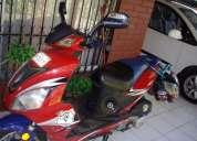 vendo moto scotter $ 380 mil pesos  conversable