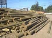Postes impregnados rollizos calibrados durmientes maderas coligues, construcciones