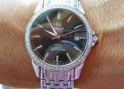 Vendo reloj de acero omega con  circones para hombre.