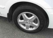 Mazda 323 blanco